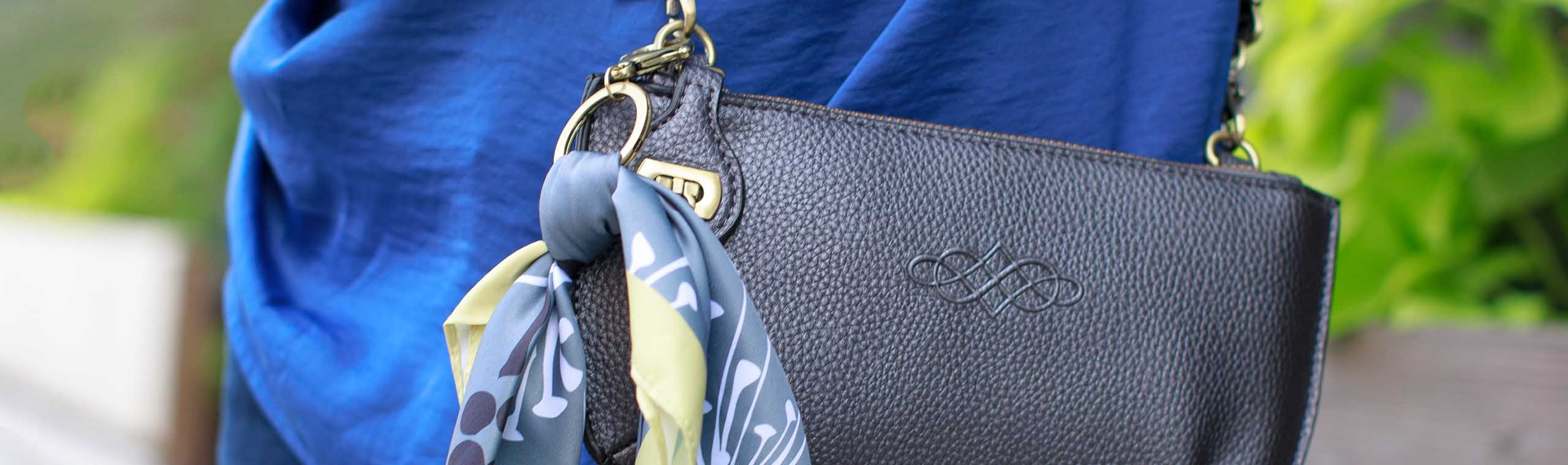 Small scarf clipped onto leather purse